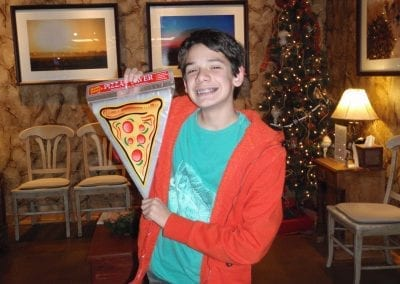 smiling with pizza